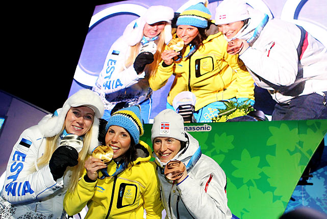 Charlotte Kalla (center) of Sweden led from start to finish to win the women's 10-kilometer freestyle race.