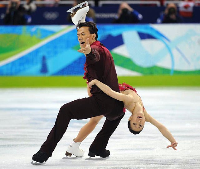 Shen Xue and Zhao Hongbo of China finally won an Olympic gold medal, outscoring teammates Pang Qing and Tong Jian in the figure skating pairs final.
