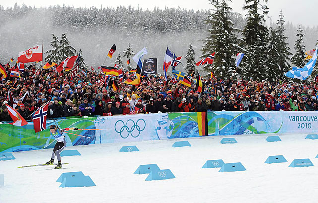 Germany's Magdalena Neuner won the women's 10-kilometer biathlon pursuit on Tuesday, holding off Slovakia's Anastazia Kuzmina - the pair exchanging podium places after the first two women's races. Kuzmina beat Neuner for gold in the 7.5K sprint, on Saturday, the first day of full competition.