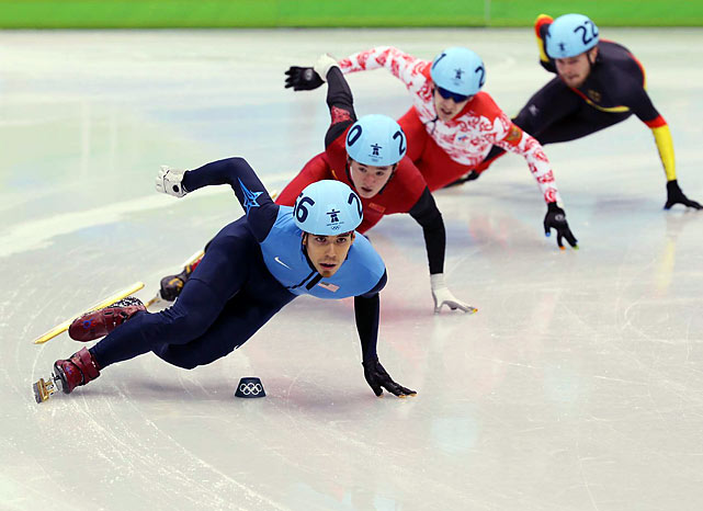 Short-track speedskater Apolo Ohno easily advanced through preliminaries of the men's 1,000 and helped the United States move on to the 5,000 relay final. Both finals are Saturday, when Ohno can become the most decorated U.S. Winter Olympian in history.