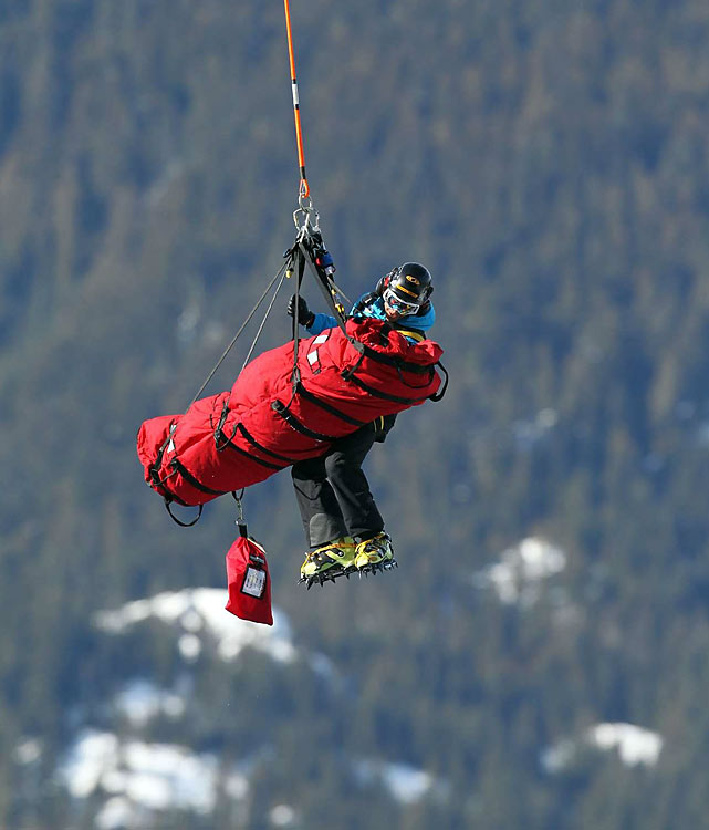 The downhill was interrupted for about a half-hour while Edith Miklos, a 21-year-old Romanian, was airlifted off the course by helicopter.