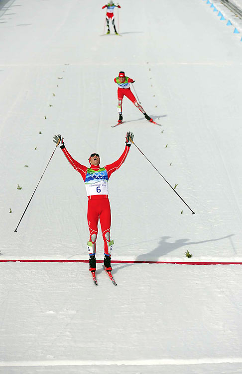 Battling against bad weather and a history of Americans missing the podium in the Nordic events, Bill Demong (6) and Johnny Spillane captured gold and silver, respectively, in the combined Nordic hill race.