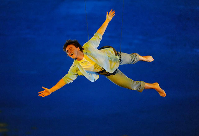 """An acrobat on wires performed an aerial ballet to the strains of Joni Mitchell's """"Both Sides Now."""""""