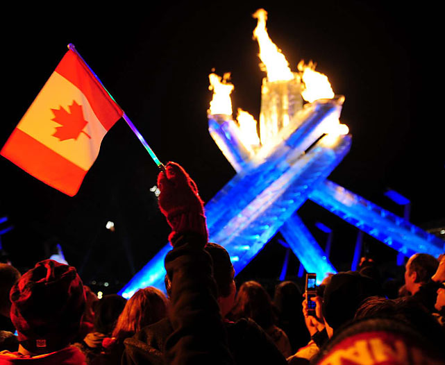 The flame reached the stadium after a 106-day torch relay across Canada, passing through more than 1,000 communities in every province and territory.