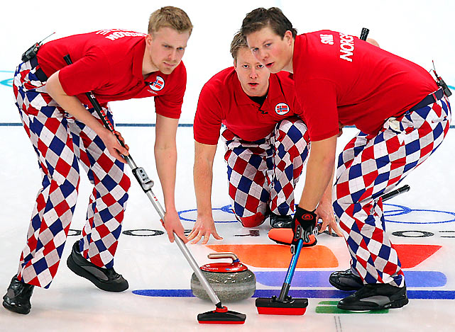 Torger Nergaard (center) of Norway releases the stone in a round-robin match against Canada, but he and his teammates were hardly the most colorfully clad athletes at Vancouver. Here's a look at some of the more eye-catching outfits at the Olympics.