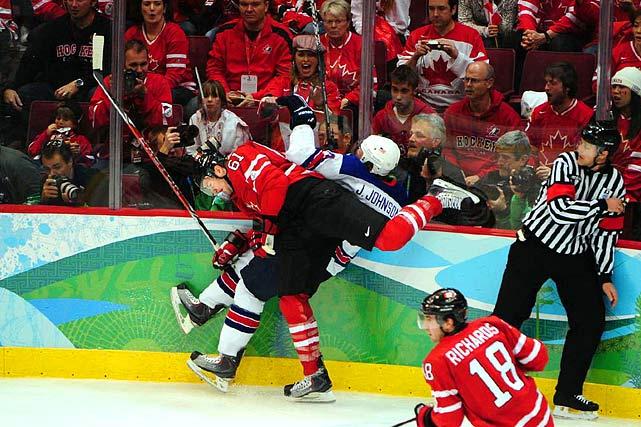 Canadian winger Rick Nash throws his body into defenseman Jack Johnson along the boards.