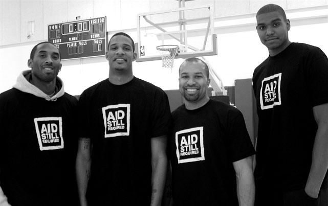 Bryant and then-Lakers teammates Trevor Ariza, Derek Fisher and Andrew Bynum flash a smile at practice in 2007.