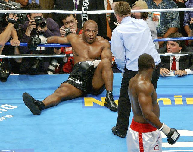 Mike Tyson lays on the canvas after being knocked out by Danny Williams in the fourth round of their non-title bout in Louisville, Ky.