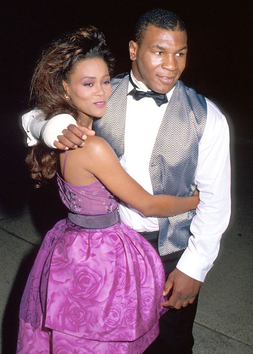 Mike Tyson poses with his first wife, actress Robin Givens, at a Los Angeles party.