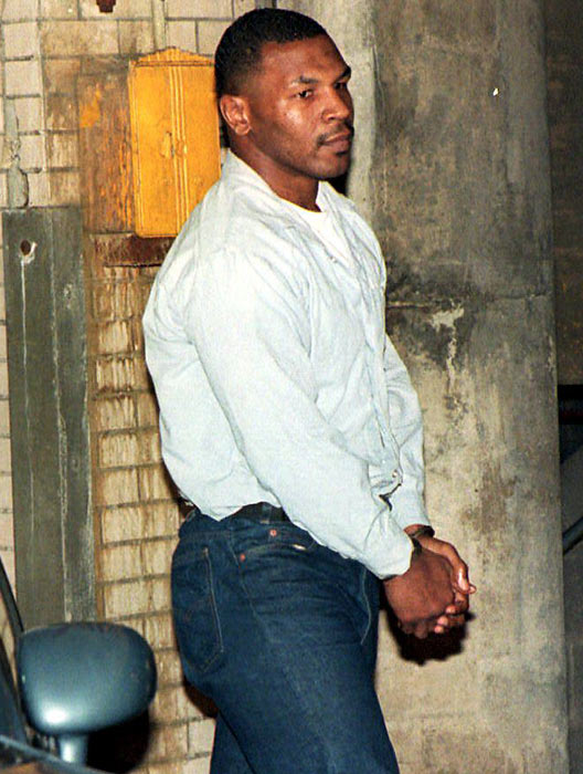Mike Tyson walks into the Marion County Courthouse after being convicted of rape in an Indianapolis courtroom.