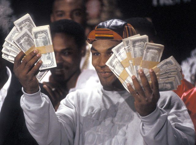 Mike Tyson shows off his money during a press conference for his 1989 fight against Carl Williams.