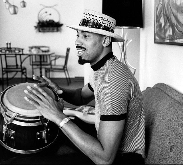 Chamberlain practices his percussion skills in his New York city apartment.
