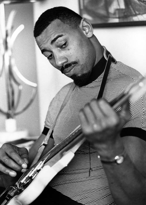 Drums aren't the only instrument Chamberlain can play. In this photo, Wilt works on his guitar playing.