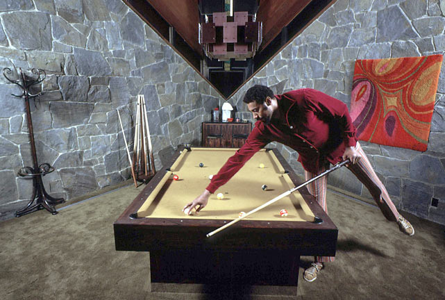 Seen here playing pool, Chamberlain named his sprawling Bel-Air home Ursa Major as an ode to the stars that make up the Big Dipper.