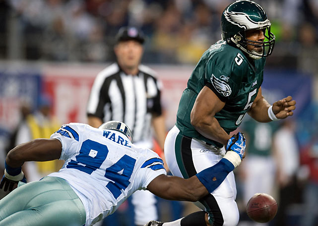 DeMarcus Ware strips Donovan McNabb of the ball on a day when McNabb also threw an interception and incurred his first opening-round playoff loss in seven career playoff seasons.