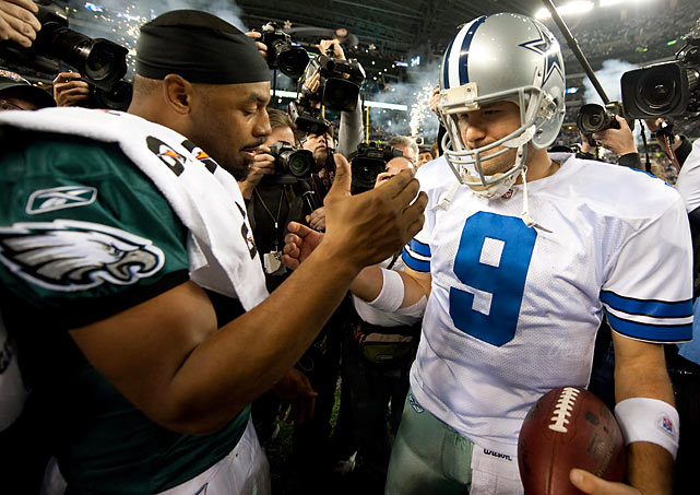 Donovan McNabb congratulates Tony Romo after the first playoff win in the Dallas quarterback's career.