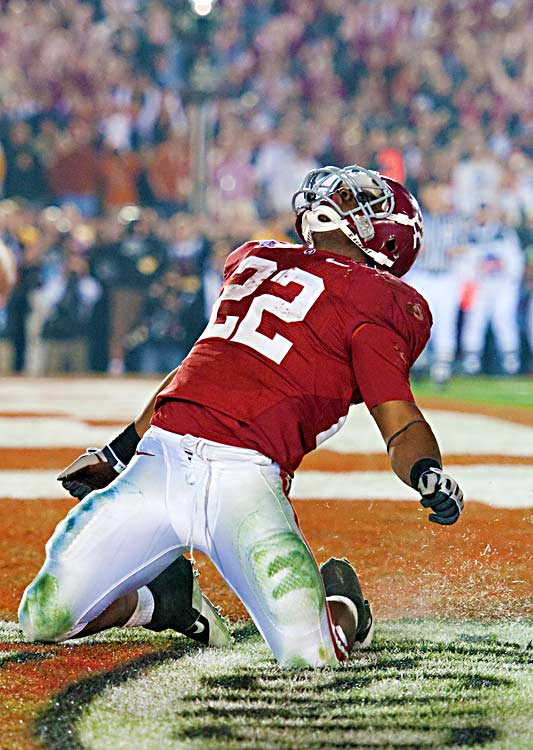 Alabama running back Mark Ingram celebrates one of two touchdowns he scored against Texas. The Longhorns, who previously boasted the nation's top rushing defense, could not stop the Heisman winner or backup Trent Richardson.