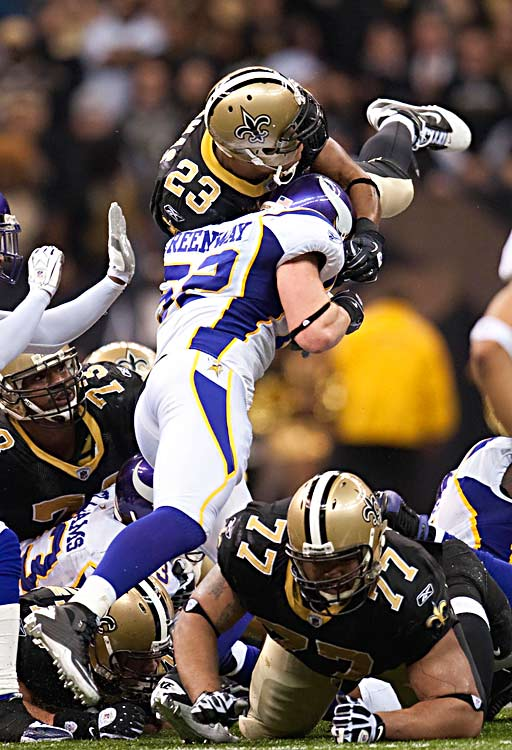 Minnesota linebacker Chad Greenway tries to stop Saints running back Pierre Thomas on a pivotal fourth-down play. Thomas appeared to lose the ball for a second but got the first down as the Saints went on to win.