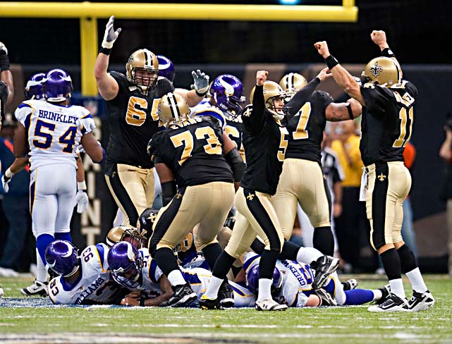 Garrett Hartley (5), holder Mark Brunell (11) and the Saints linemen kick off the celebration.