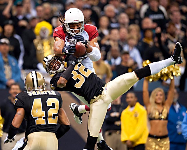 Jabari Greer (32) and Larry Fitzgerald fight for possession in the Saints' 45-14 victory over Arizona in the second round of the playoffs.