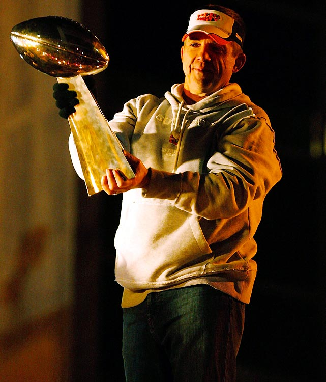 Coach Sean Payton blew kisses to the crowd as he held the Lombardi Trophy over his head.