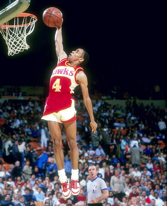 Atlanta's Spud Webb scores two perfect scores of 50 to beat teammate Dominique Wilkins in Spud's hometown of Dallas during the All-Star weekend Slam Dunk Contest.