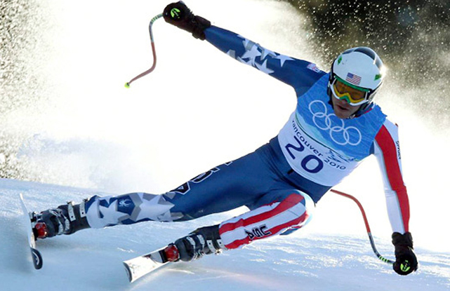 Bode Miller won the first gold medal of his Olympics career, taking the super-combined with plenty of flair -- roaring back from seventh after the downhill with a blazing slalom run. Miller's victory bumped the U.S. medal count to seven gold and24 overall to lead all countries.