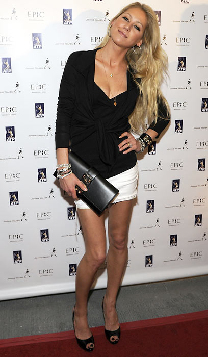 Anna Kournikova poses on the red carpet at the ATP Sony Ericsson party at the Epic night club in Miami.