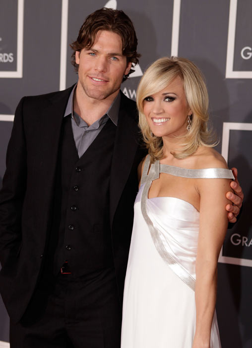 Mike Fisher and singer Carrie Underwood arrive at the 52nd Annual GRAMMY Awards in Los Angeles.