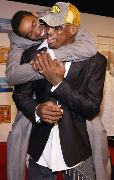 Former teammates Isiah Thomas and Dennis Rodman walk the red carpet during the 2004 NBA All-Star weekend.