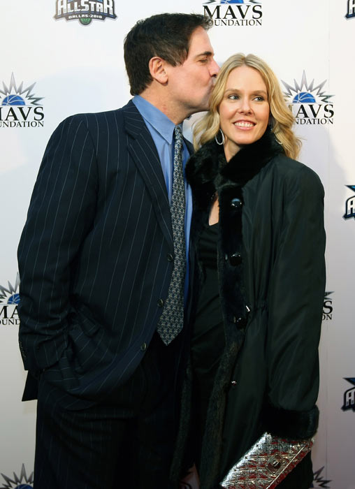 Mark Cuban kisses his wife Tiffany Cuban on the red carpet during a NBA Tip-Off Party as part of the 2010 NBAAll-Star Weekend in Dallas.