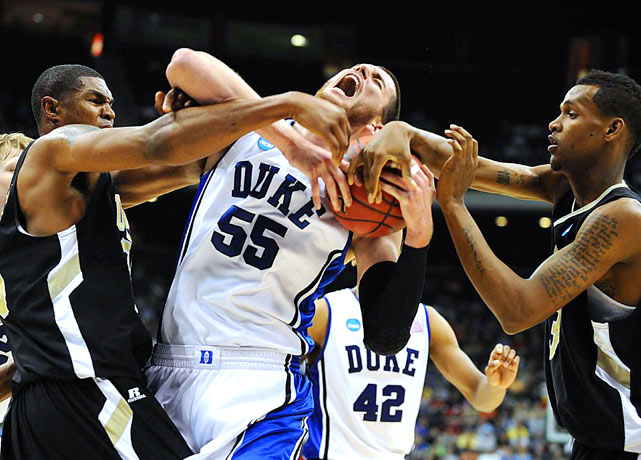 Duke center Brian Zoubek battles for possession against the Arkansas-Pine Bluff Golden Lions during Duke's 77-44 victory on March 19 in Jacksonville.