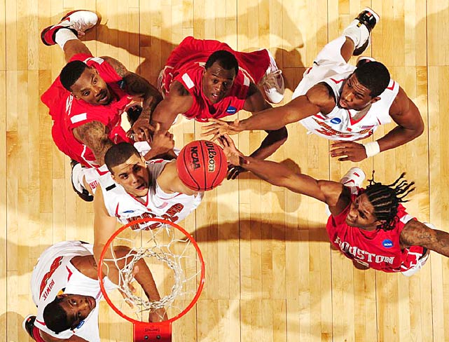 The Maryland Terrapins (white) vie for a rebound against the Houston Cougars during first-round tournament action on March 19 in Spokane. Maryland defeated Houston 89-77.