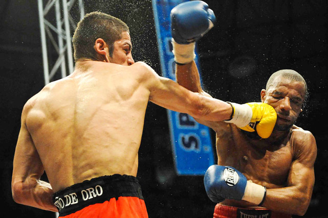 WBA super featherweight and WBC featherweight champion Jorge Linares of Venezuela finds  the chin of Francisco Lorenzo of the Dominican Republic on March 27 in La Guaira, Venezuela. Linares won by majority decision.