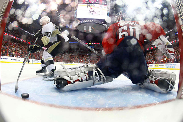 Pittsburgh center Sidney Crosby scores against Washington goalie Jose Theodore on March 24 at the Verizon Center in Washington, D.C. The Capitals won 4-3 in a shootout.