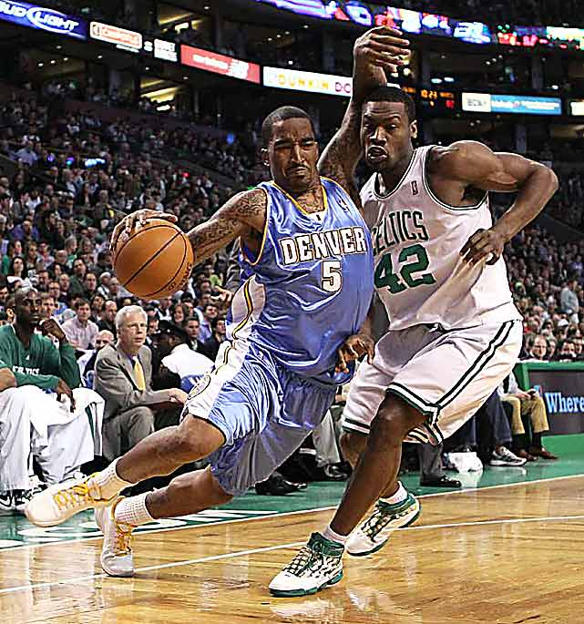Denver guard J.R. Smith drives to the hoop while being defended by Boston's Tony Allen on March 24 at TD Banknorth Garden in Boston. The Celtics defeated the Nuggets 113-99.