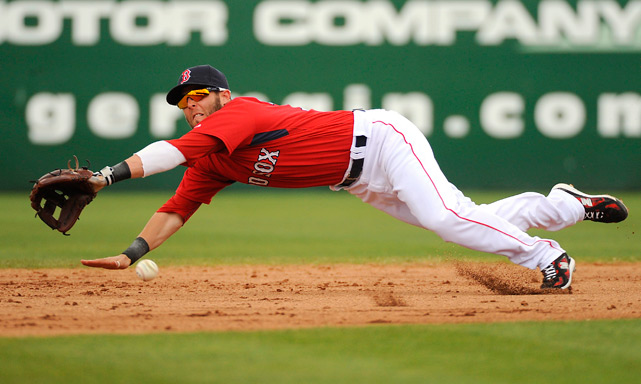 Boston second baseman Dustin Pedroia dives for the ball during their spring training game against the Tampa Bay Rays in Ft. Meyers, Fla., on March 10. Pedroia went 2 for 3 on the day but the Rays defeated the Red Sox 8-6.