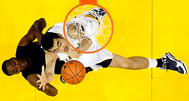 Jeremy Jacob of the Oregon Ducks and Max Zhang of the Cal Golden Bears battle for a rebound during the quarterfinals of the Pac-10 tournament at Staples Center on March 11 in Los Angeles. Cal defeated Oregon 90-74.