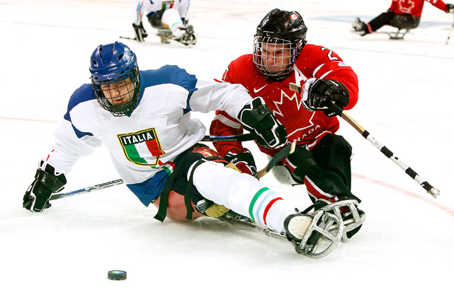 Gianluigi Rosa of Italy holds off Brad Bowden of Canada during their Ice Sledge Hockey preliminary at the 2010 Vancouver Winter Paralympic Games on March 13. Canada defeated Italy 4-0.