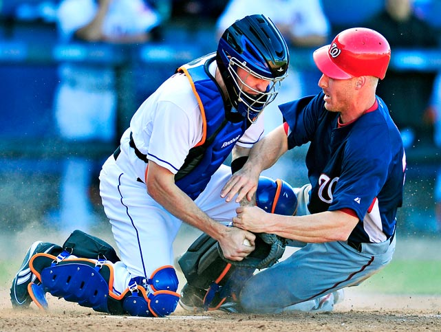 Washington Nationals' infielder Pete Orr is out at the plate as he collides with New York Mets catcher Chris Coste during their spring training game on March 7 in Port St. Lucie, Fla. The Mets edged the Nationals 6-5.