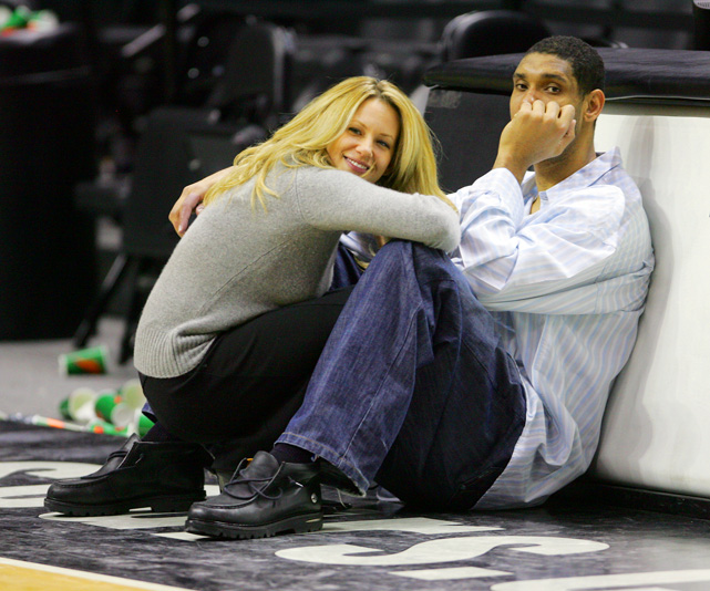 Tim Duncan and his wife, Amy, curl up on the baseline of the AT&T Center in San Antonio, perhaps in an effort to avoid having this photo taken.