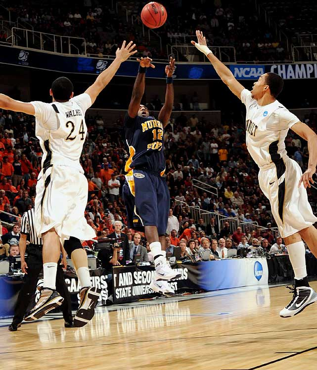 Day 1 of the NCAA Tournament was no snoozer. Here are some of SI's best shots from opening day.<br><br>Senior Danero Thomas finished with 11 points, but none bigger than this jumper as time expired to send the 13th-seeded Racers into the second round after its upset of Vanderbilt.