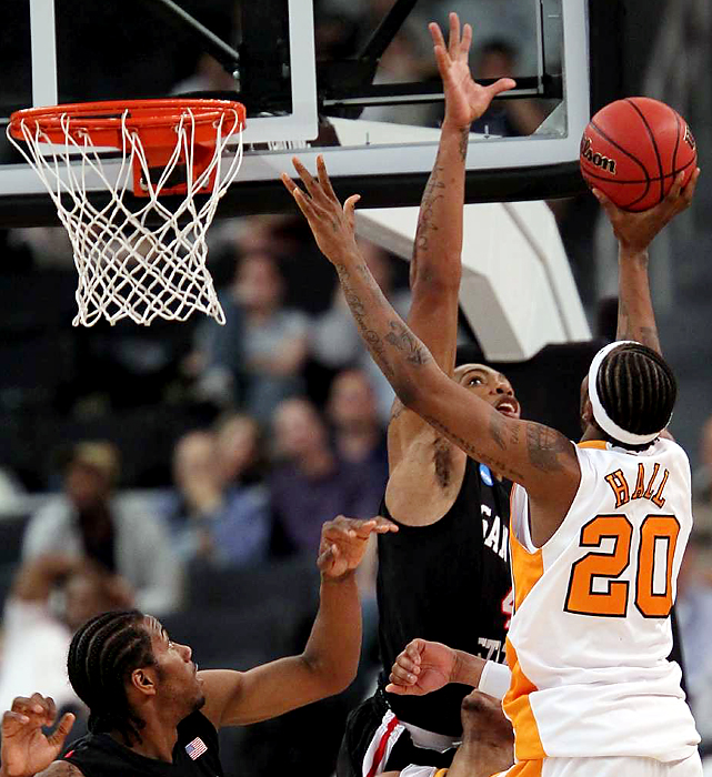 Freshman Kenny Hall fell short in this shot attempt, but Tennessee, behind Melvin Goins' fourth 3-pointer with 19 seconds left, kept San Diego State winless in the NCAA tournament. The Vols, seeded sixth, will face upstart Ohio on Saturday.