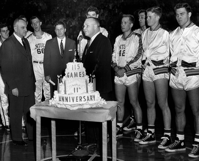 Coach Adolph Rupp is honored for the team's 115-game home winning streak. The streak began in 1943 and lasted 130 games, until Georgia Tech won in Memorial Coliseum on Jan. 8, 1955. The streak still stands as the longest in NCAA history.
