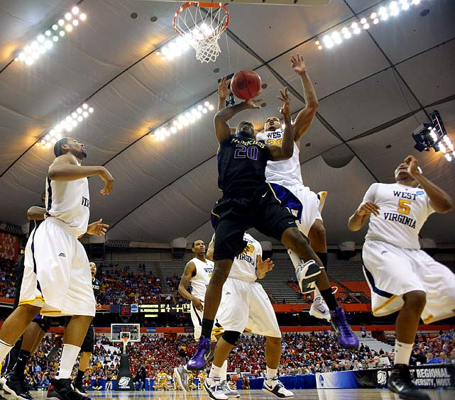 West Virginia held Washington's Quincy Pondexter (19.4 PPG) to just seven points, and clinched an Elite Eight appearance without the services of point guard Darryl Bryant, who broke his foot during practice.