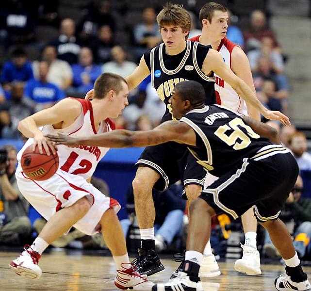 Jason Bohannon (left) wasn't going to let fourth-seeded Wisconsin fall into Wofford's trap. Jon Leuer finished with 20 points and Trevon Hughes added 19 as UW advanced to face Cornell.