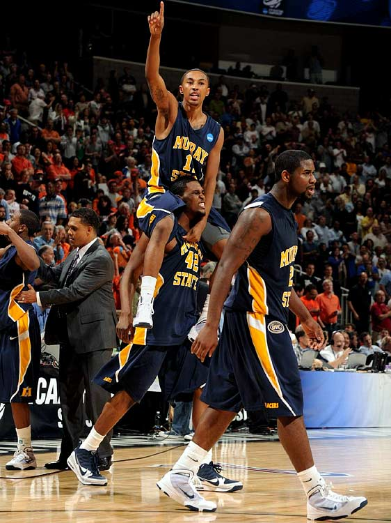 Donte Poole (11), Ivan Aska (42) and Edward Daniel (2) after the Racers upset of Vanderbilt.
