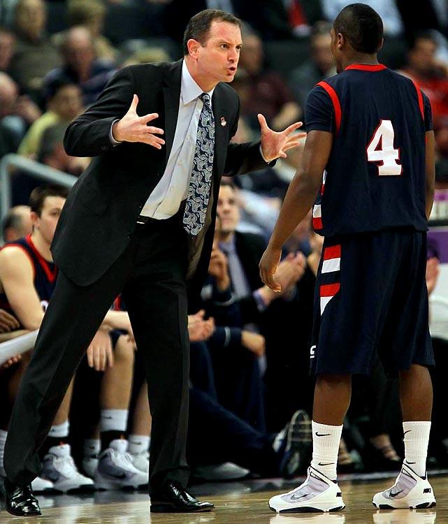 Coach Mike Rice scolding Karon Abraham.