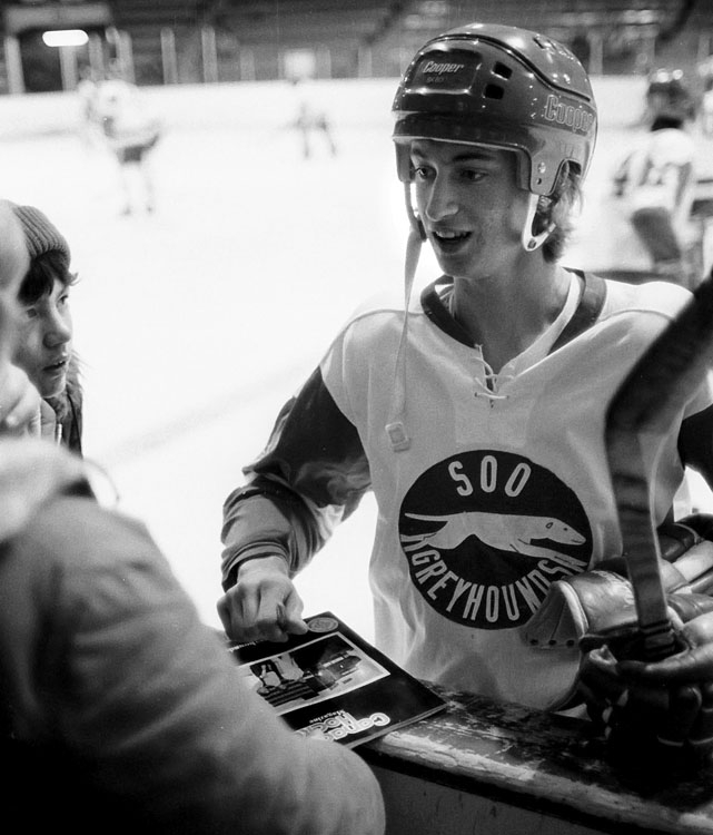 The teen star signs autographs for fans before a game against the Hamilton Fincups. Later that year, he began his pro career by signing a personal services contract with the owner of the Indianapolis Racers of the World Hockey Association, the NHL's rival. The NHL draft age was 20, and Gretzky, then 17, wanted to turn pro without having to spend another three years in juniors.