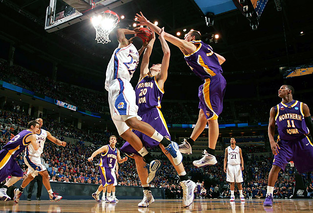 UNI went right at the Jayhawks, opening with a 10-2 run, and its defense frustrated Marcus Morris (with ball) and Kansas throughout the game.